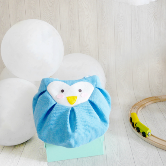 blue penguin mochi bag front balloons with train set