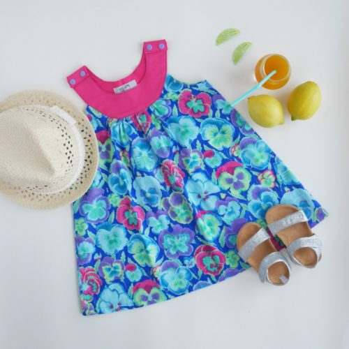 Dark floral Ruby Series Dress with hat and lemons