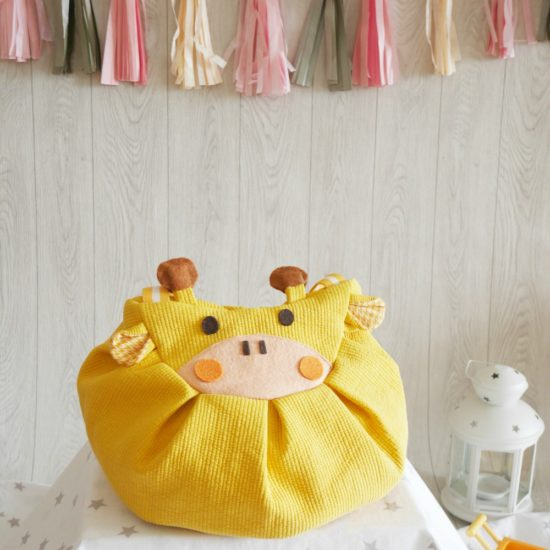 Yellow giraffe mochi bag backpack with banner
