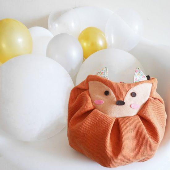 orange fox mochi bag with balloons