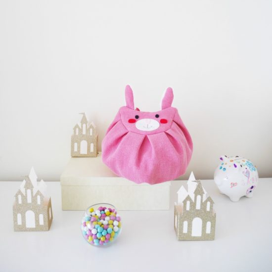 front pink bunny mochi bag with castle