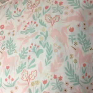 fabric for bespoke children's cheongsam. Pink unicorns on white field