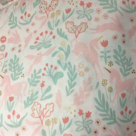 fabric for bespoke children's cheongsam. Pink unicorns on white field