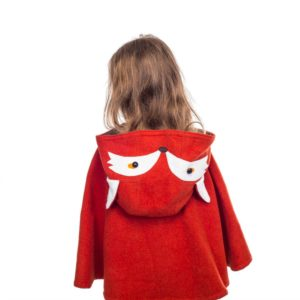 girl wearing bespoke cape coat