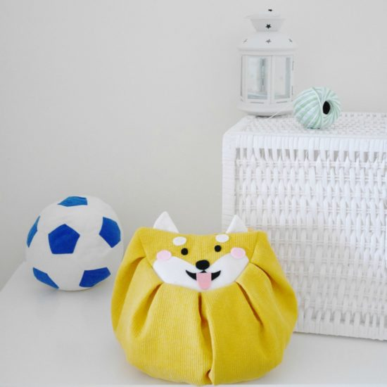 Front yellow dog mochi bag with soccer ball