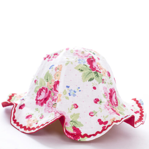 reversible child's sunhat with pink floral detailing